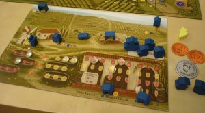 Player vineyard board showing all the structures you can build, the workers and grande worker, and the clear grape/wine tokens. The quality of the components and art is excellent